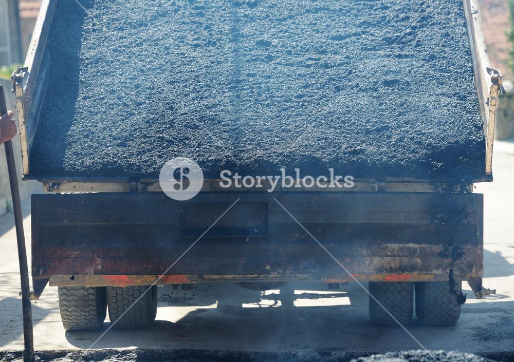 Truck on asphalt construction