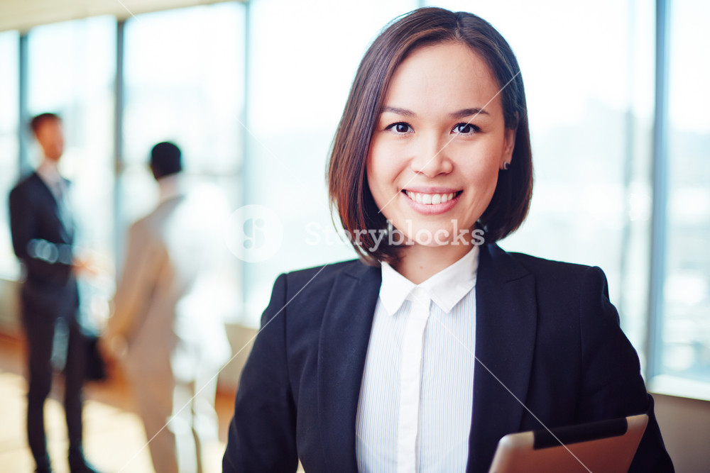 Female Business Leader Looking At Camera