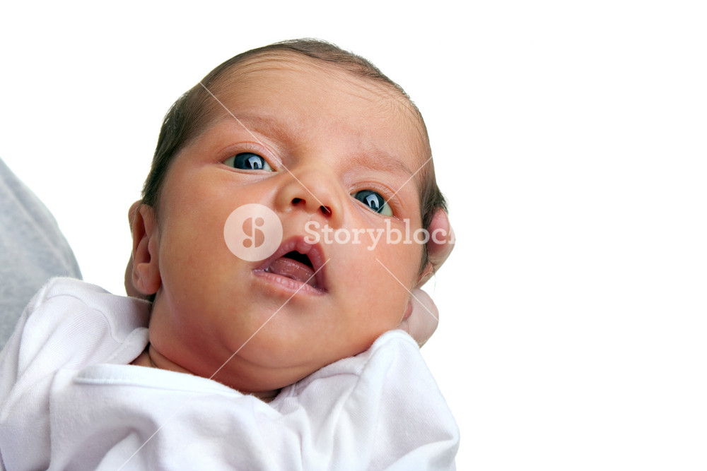 A cute newborn baby girl isolated over a white backdrop.