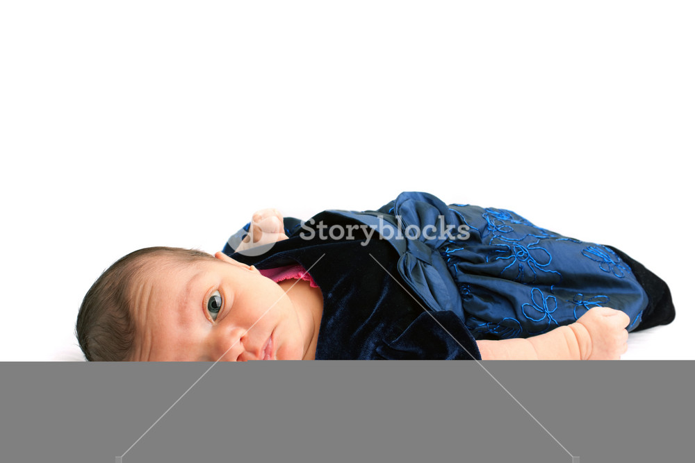 A cute newborn baby infant isolated on a white backdrop.