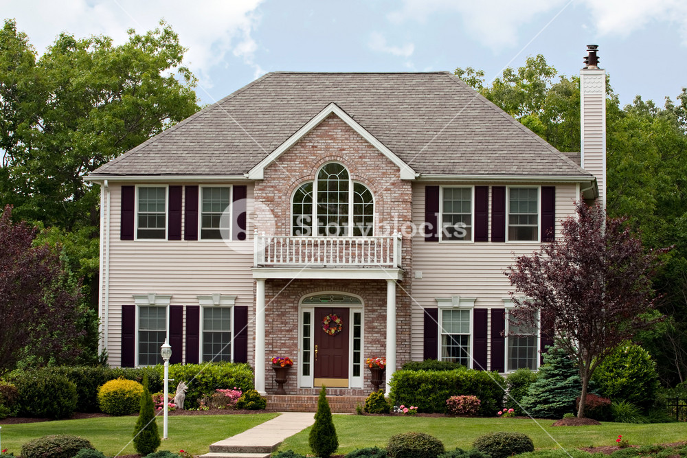 A large custom built luxury house in a residential neighborhood.  This high end home is a very nicely landscaped property.