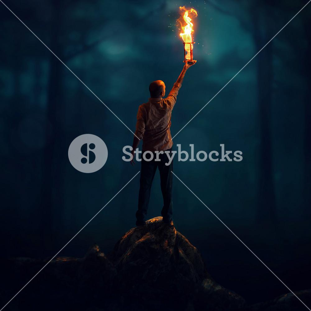 A man offers up an hourglass on fire as a sacrifice.