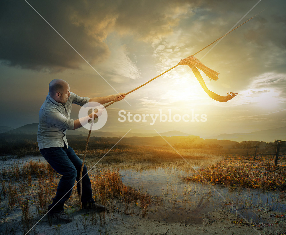 A man plays tug of war with heaven.