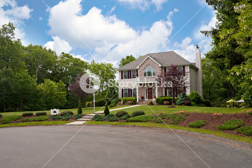 A modern custom built luxury home in a residential cul-de-sac neighborhood.  This high end house is very nicely landscaped property.