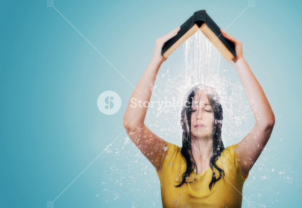 A woman holds a Bible over her head with water pouring out