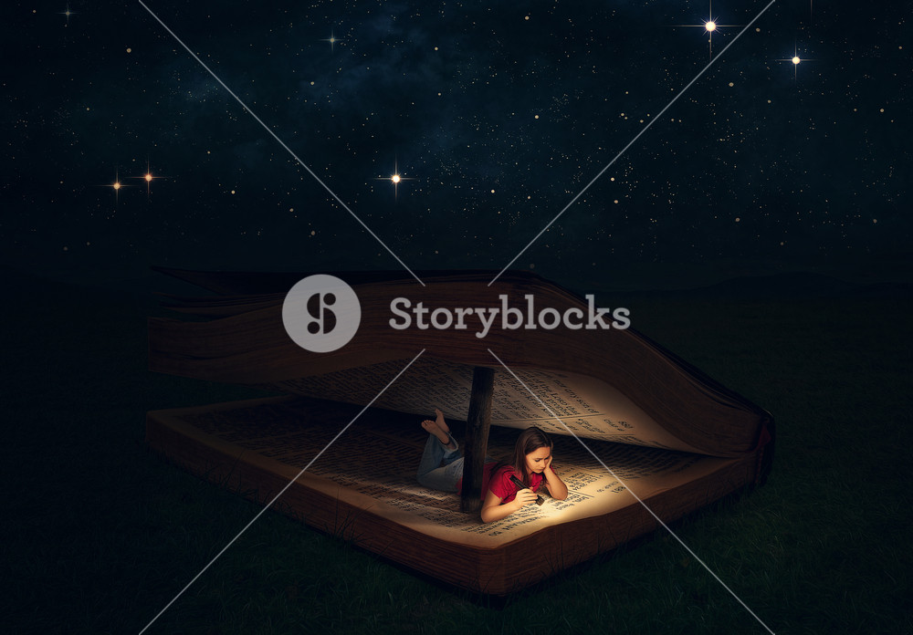 A woman is reading inside a huge Bible at night under the stars.