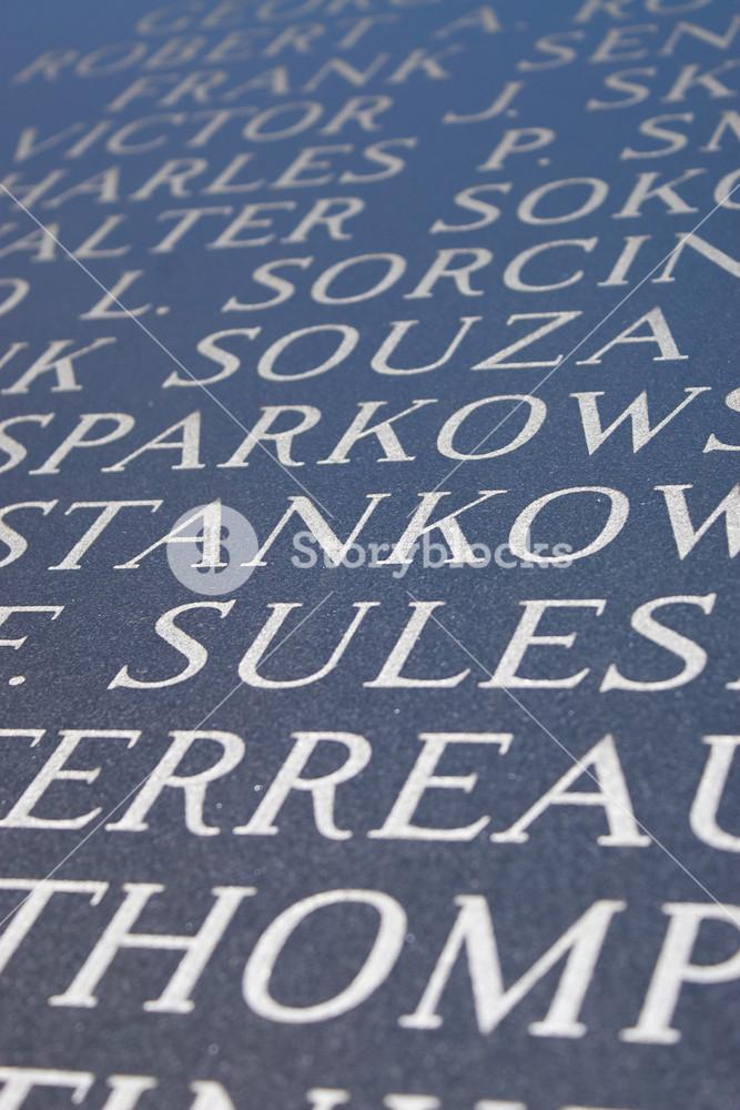 Abstract closeup of engraved names on the Iwo Jima war memorial.
