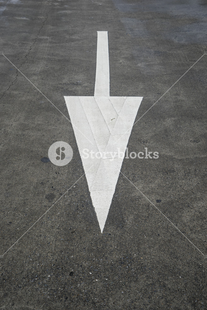 Arrow sign on texture road.