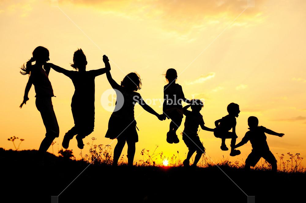 Beautiful scene of children jumping in nature
