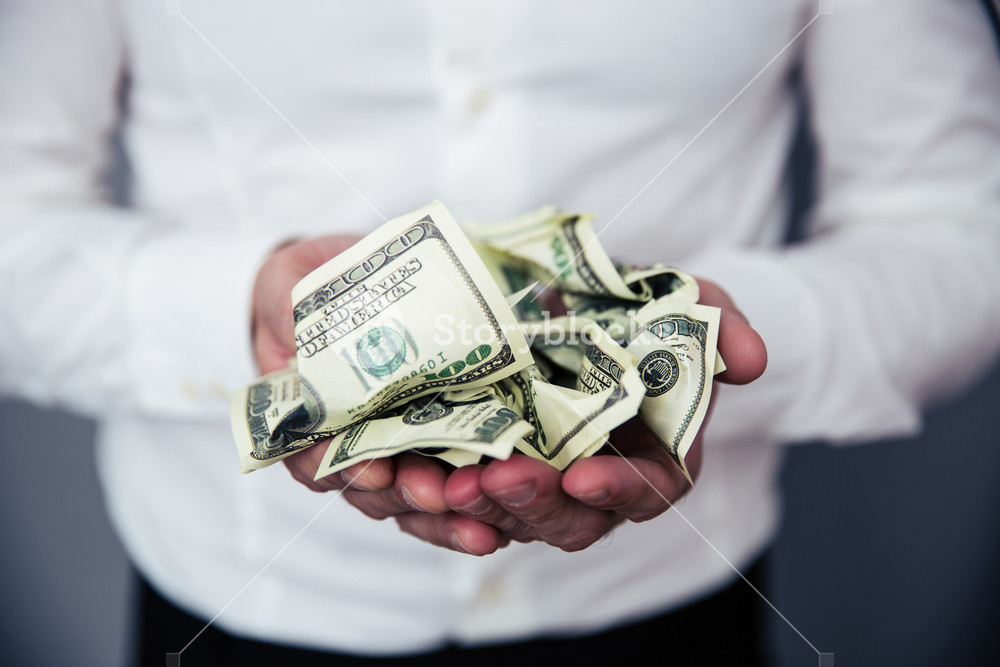 Business man hands holding money
