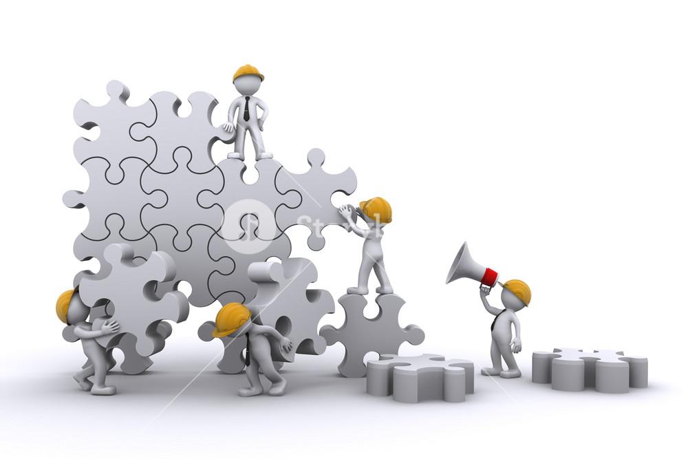 Business Team Work Building A Puzzle. Buuilding Business Concept.