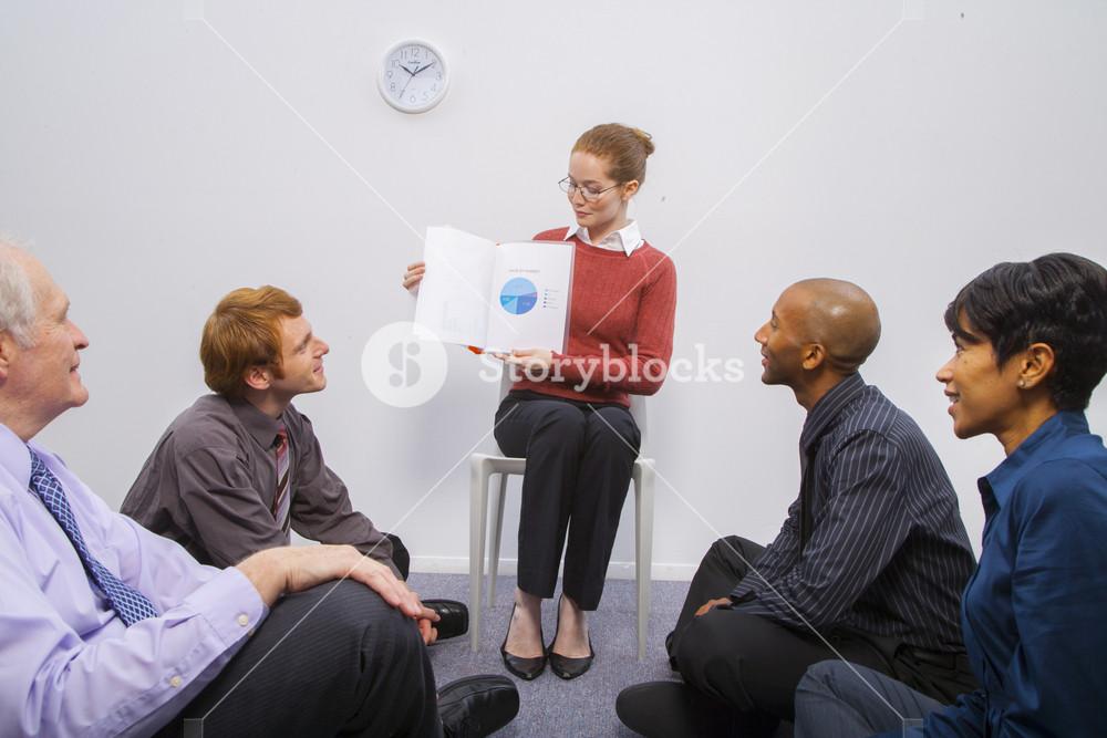 Businesswoman reading storybook