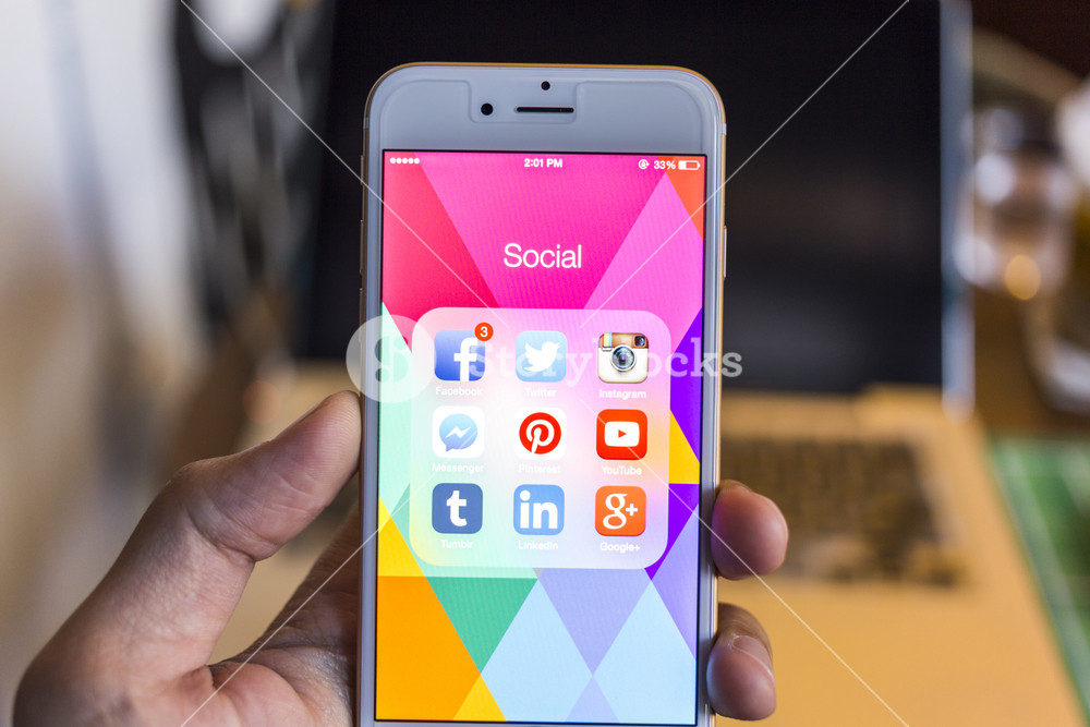 CHIANG MAI, THAILAND - JANUARY 02, 2015: All of popular social media icons on smartphone device screen with hand holding on Apple iPhone 6.