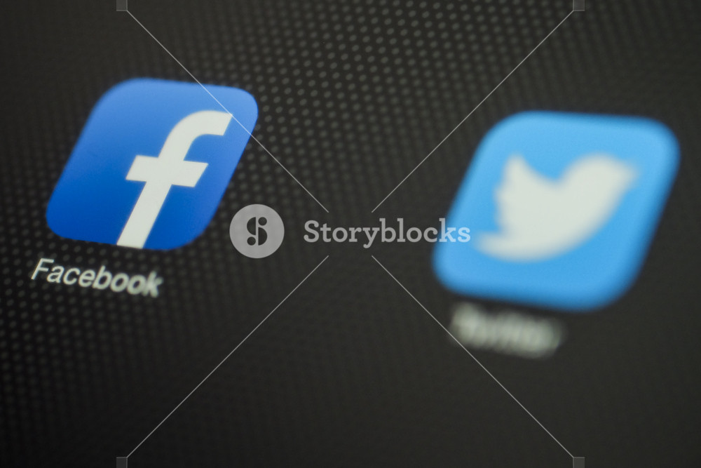 CHIANG MAI, THAILAND - OCTOBER 03, 2014: Facebook and Twitter application close up on Apple iPad Air device.