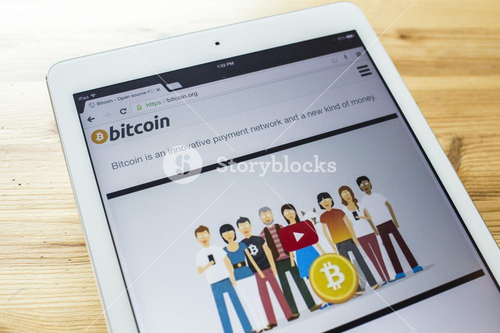 A bitcoin home page on an ipad screen
