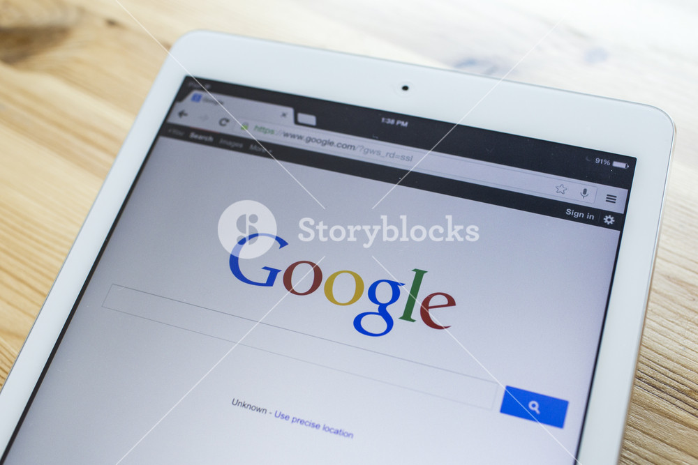 CHIANG MAI, THAILAND - SEPTEMBER 07, 2014: A Google search home page on a ipad screen, new app for mobile devices.