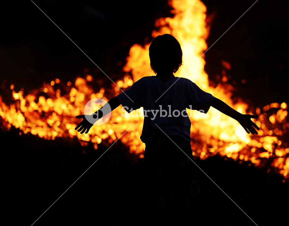 Child on fire with wide open arms