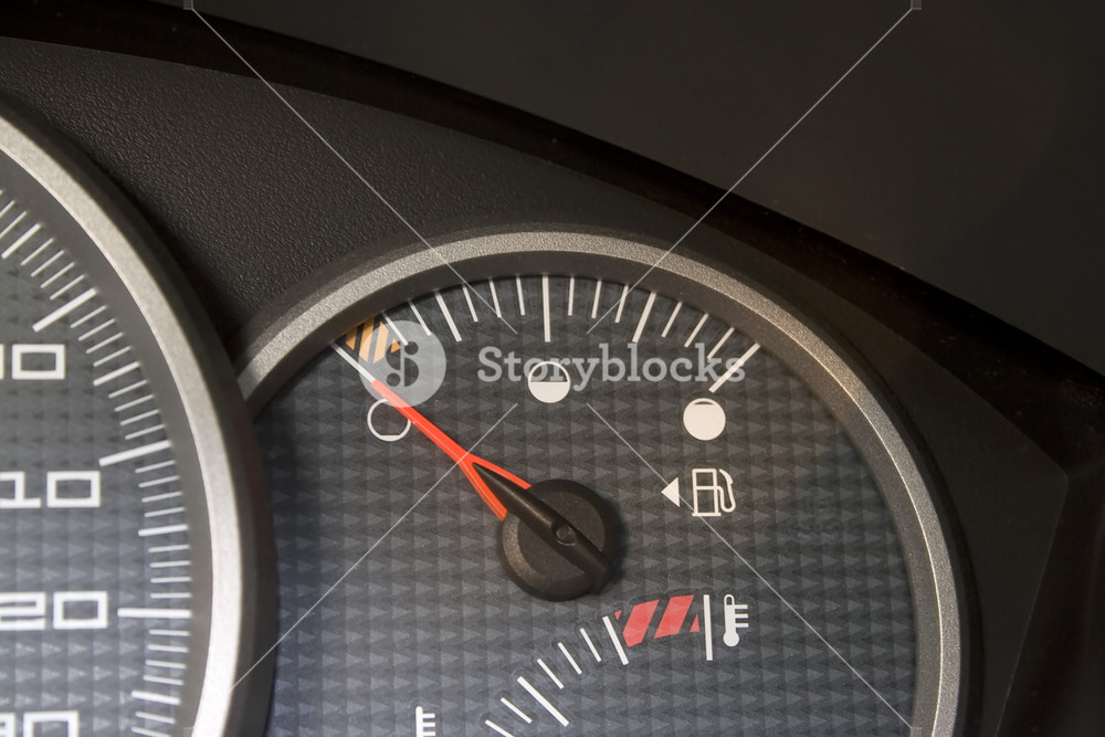 Close-up of a gas gage displaying that the car has an empty tank.
