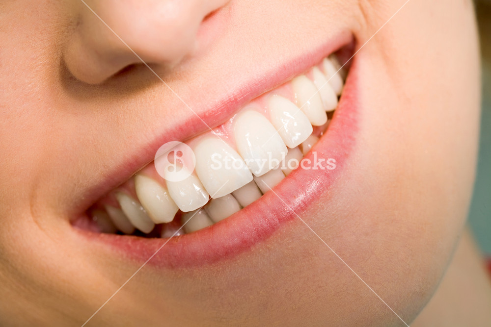 Close-up of happy female smile and healthy teeth