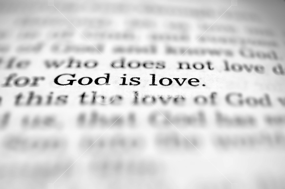Close up on the pages of the Bible that says God is love
