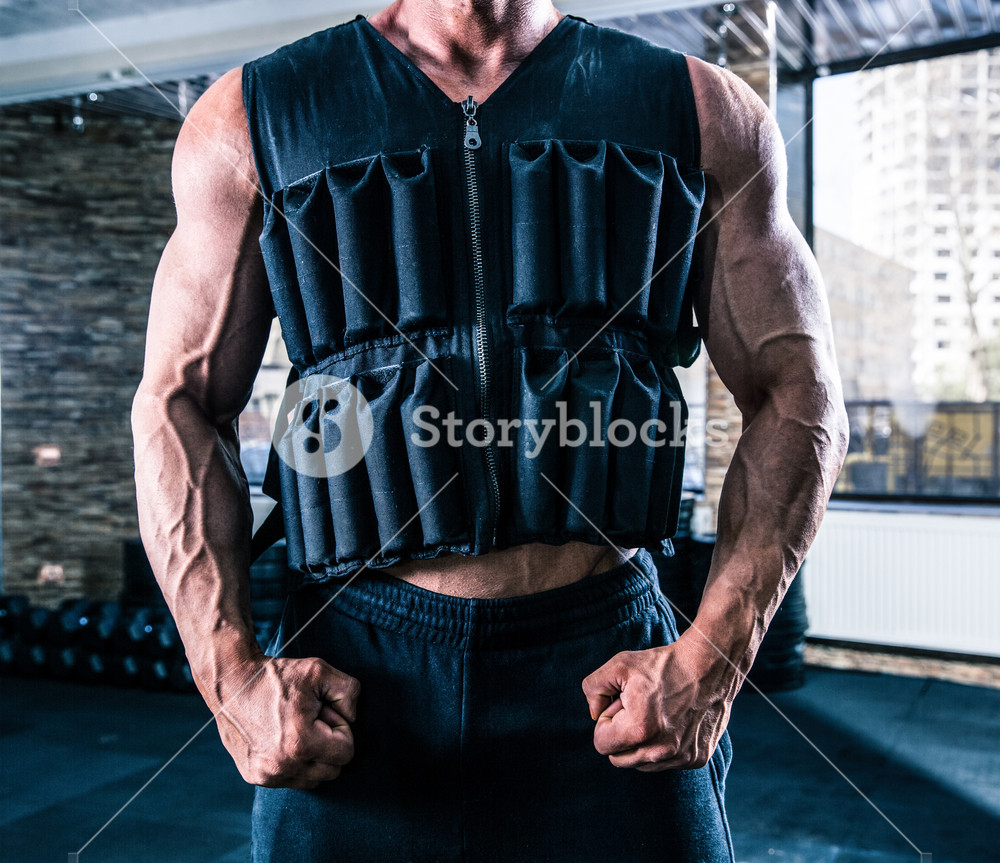 Closeup image of a man wearing in weighting cloth in gym