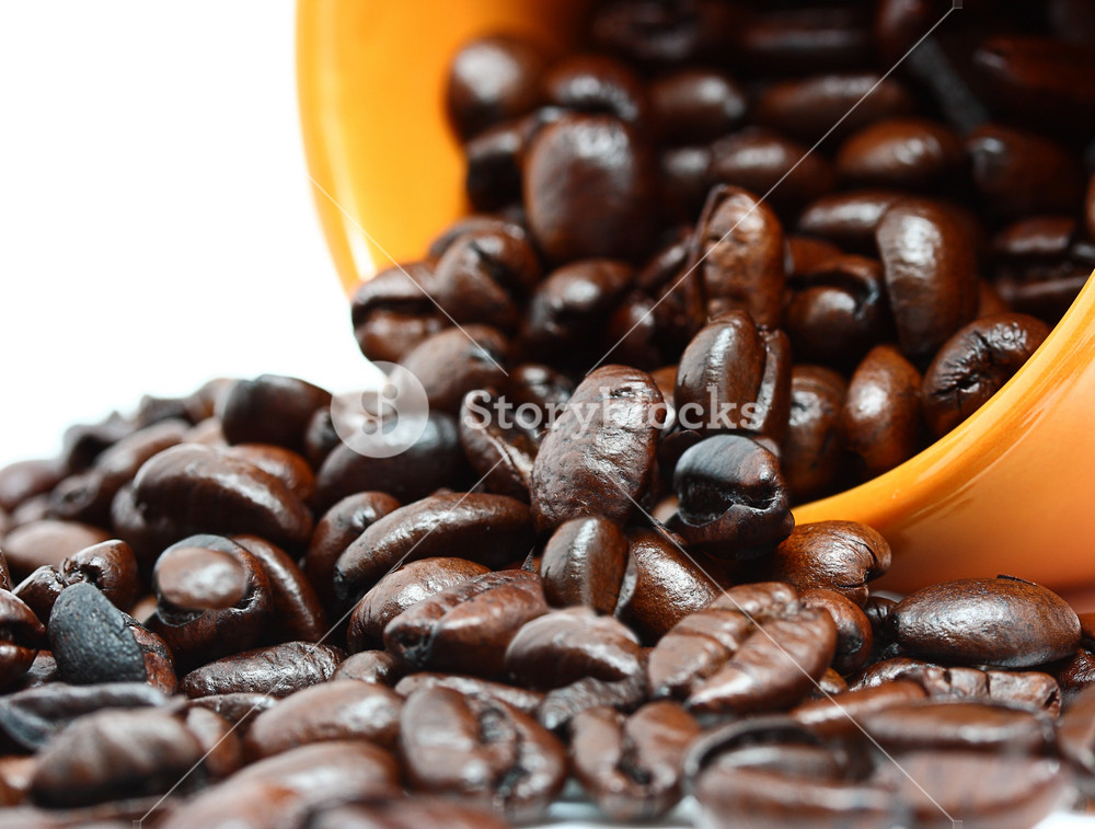 Coffee Beans In The Mug Representing Fresh Brewed Coffee
