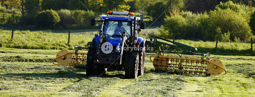 farming tractor and mowing a field, grass