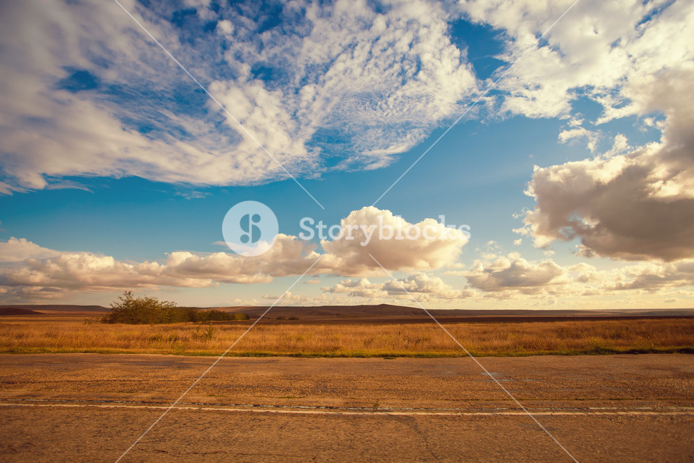 Field with cloudy sky