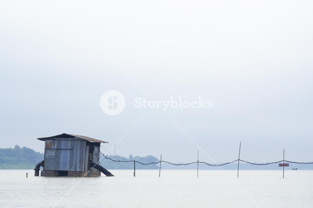 fishing hut on a lake during sunrise