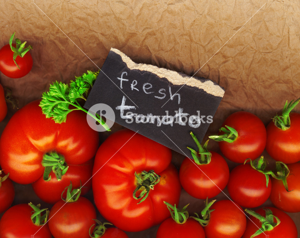 Fresh Tomatoes On The Market With A Tag
