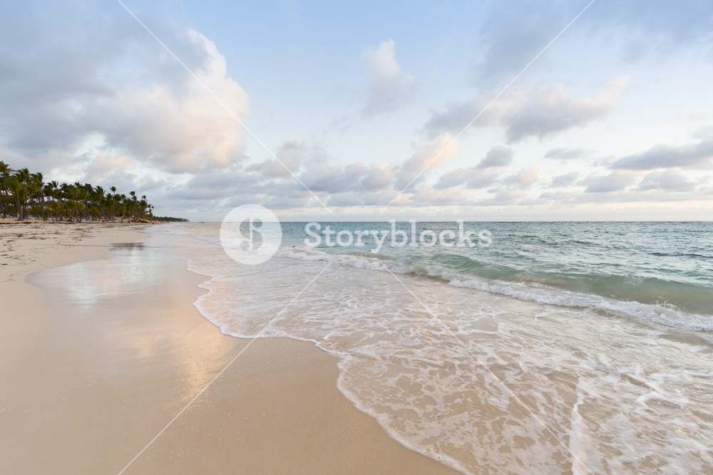 Gentle waves on the beach at sunset