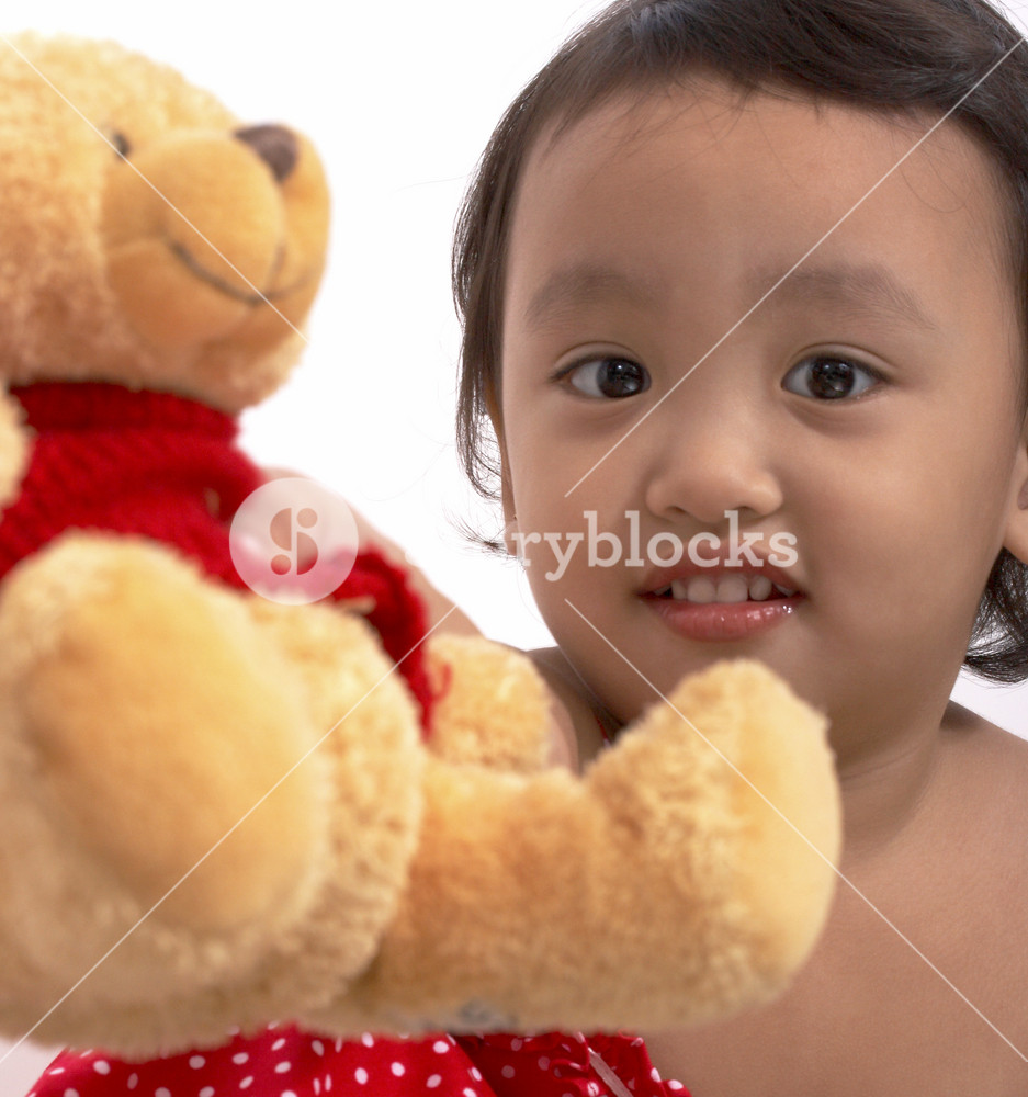 Girl Playing With Her Teddy