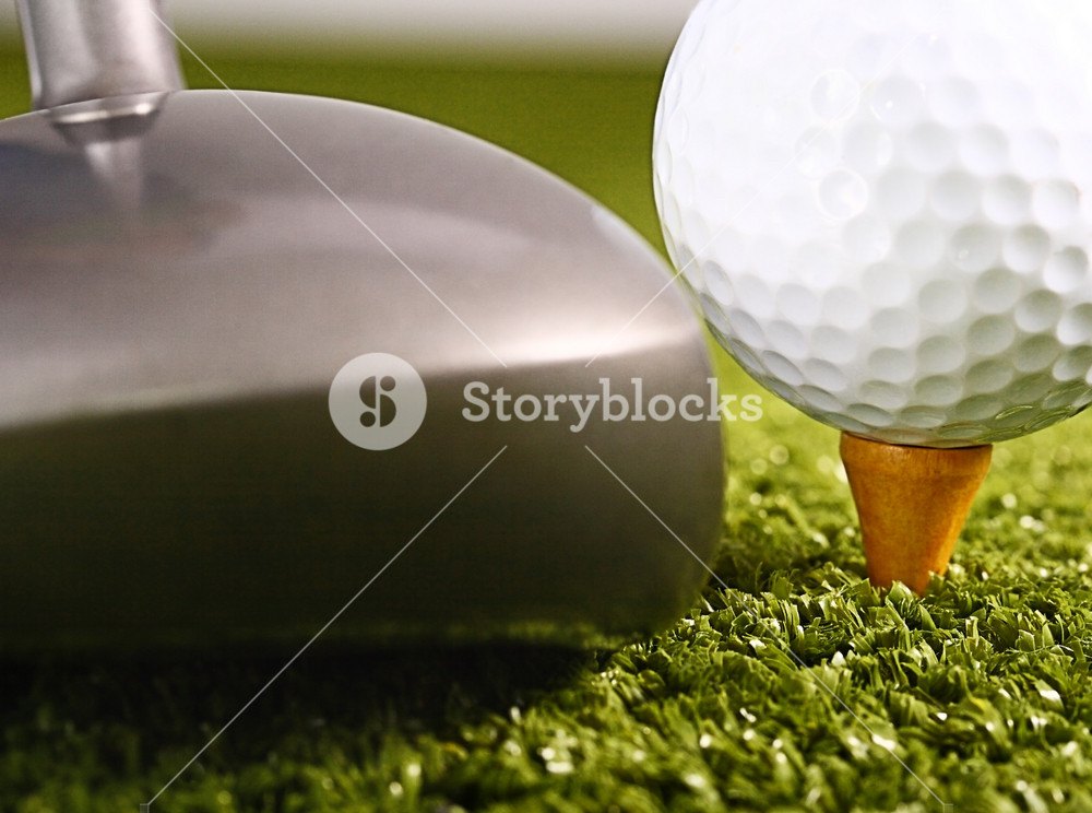 Golfer About To Drive A Golf Ball