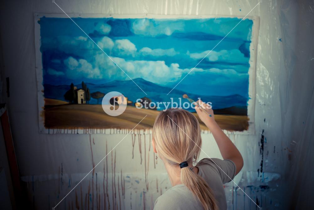 beautiful blonde woman painter in her studio