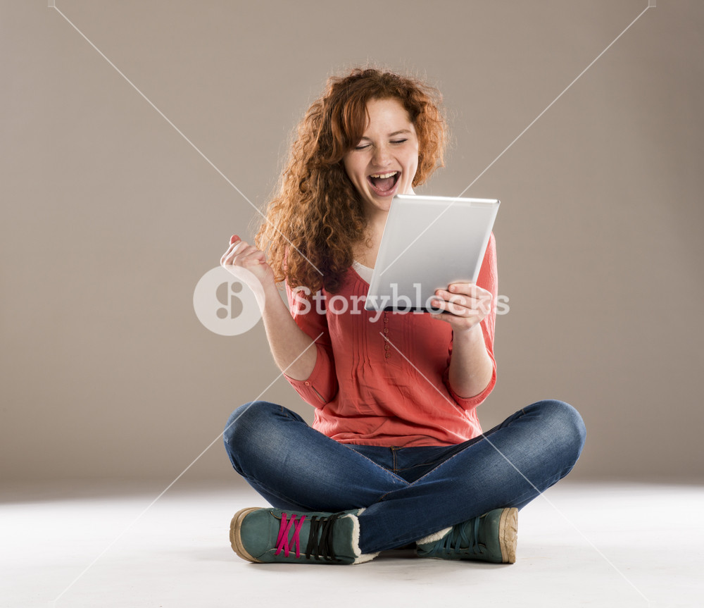 Beautiful girl with tablet is isolated on white background