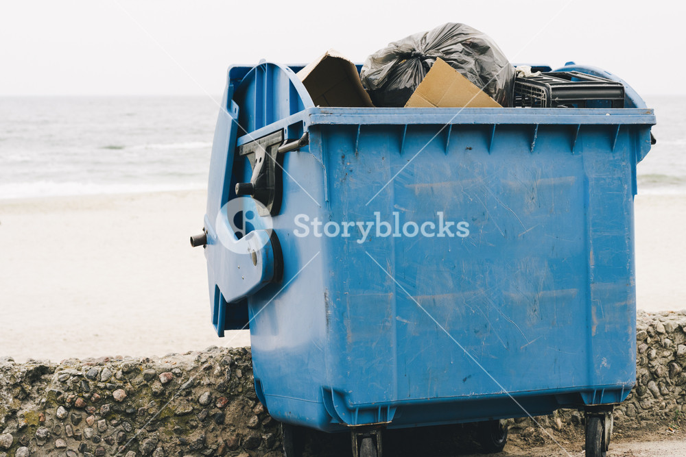 Blue garbage container on the coast