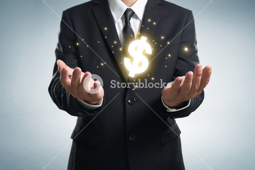 Businessman holding  dollar symbol.