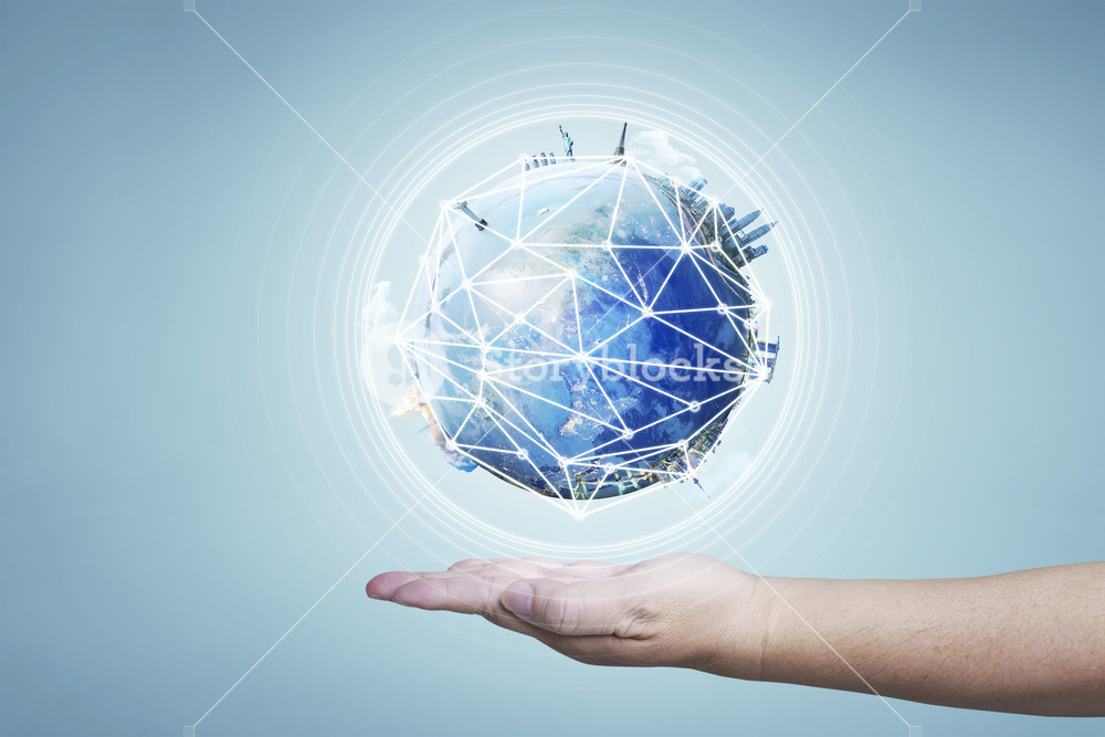 Businessman holding planet Earth in palm. Elements of this image are furnished by NASA