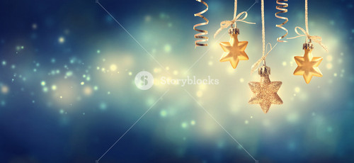 Christmas golden star ornaments at blue night