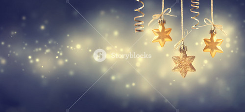 Christmas golden star ornaments hanging at night