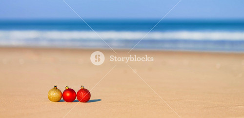 Christmas ornaments in the sand on a tropical beach