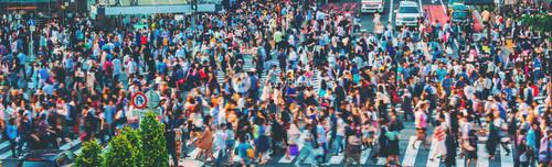 Crowds converge at Shibuya Crossing, one of the busiest crosswalks in the world. Tokyo, Japan