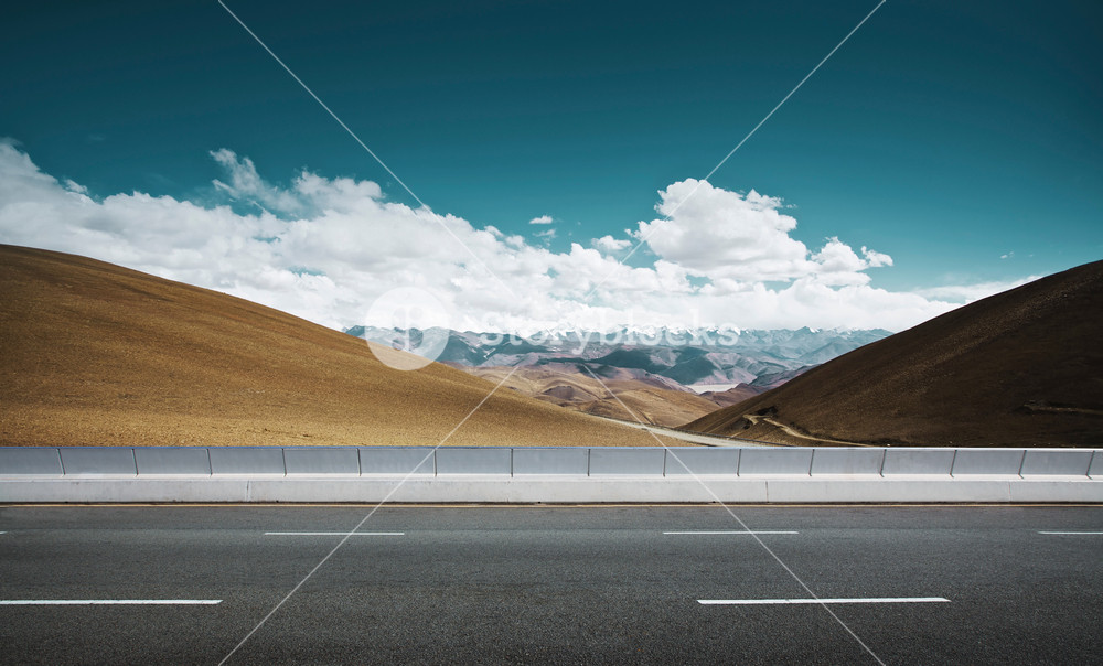 Empty asphalt road and mountain background .