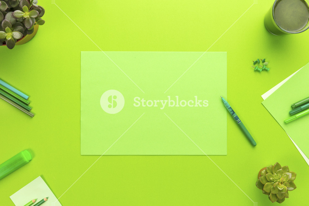 Environmental concept of a green office desk with supplies
