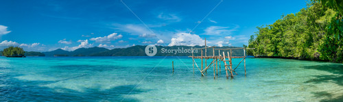 Fisherman Platform near Batu Lima, Biodiversity Resort, Gam Island, Doberai Eco in Background, Urai , West Papuan, Raja Ampat, Indonesia