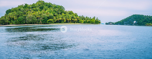 Friwen Island in Front and Friwen Wall in Background, West Papuan, Raja Ampat, Indonesia