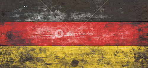 German flag, red, yellow and black stripes, painted on aged wall. Studio shot. Wooden background.