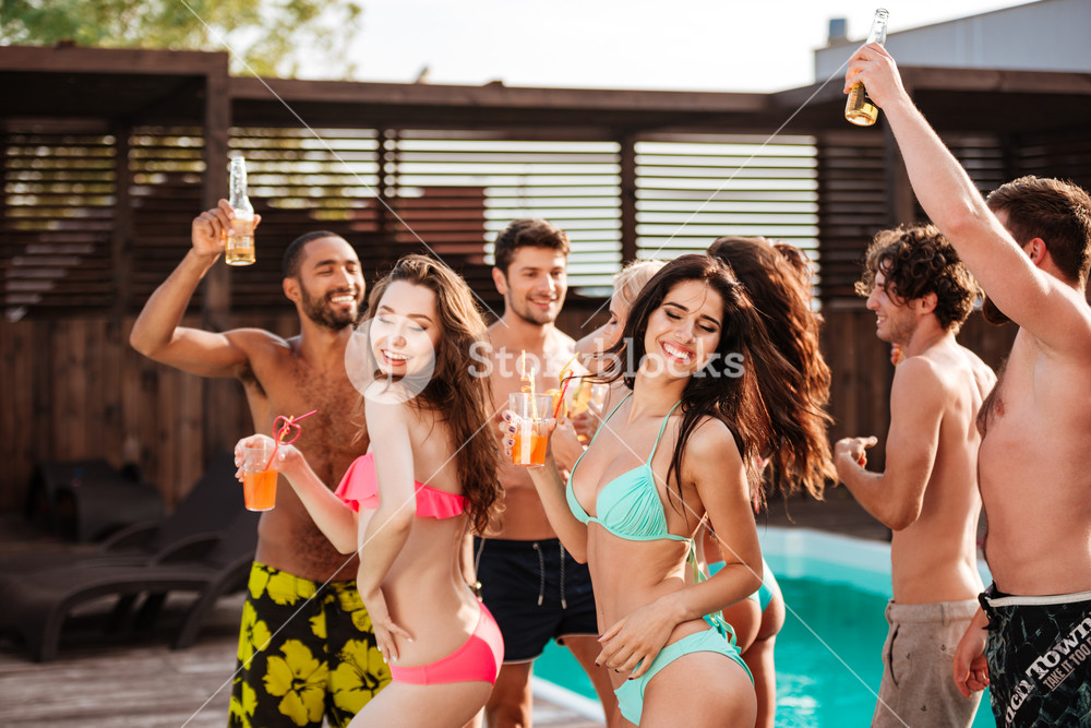 Group of best friends having fun at swimming pool outdoors