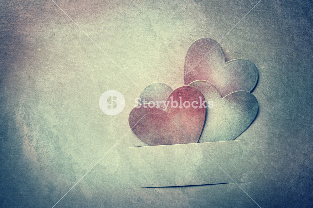 Handcrafted paper hearts in vintage desaturated tone