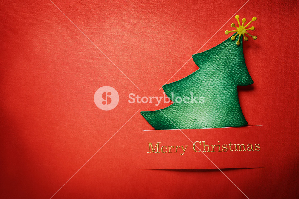 Handmade paper craft Christmas tree with Merry Christmas text